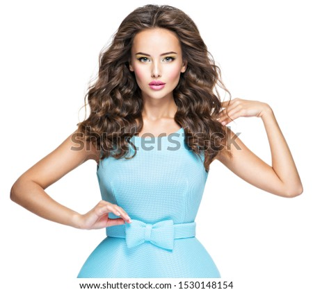Beautiful fashionable woman with long  hair in blue dress. Attractive fashion model posing on white background. #1530148154