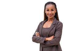 Beautiful female african american business woman CEO in a suit, isolated on white background, standing confidently with arms folded