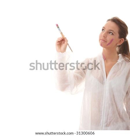 Beautiful female artist with a violet brush - isolated over white