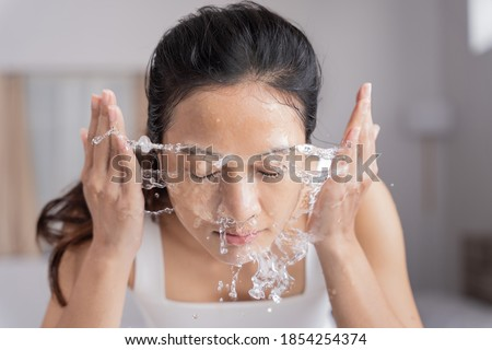 Beautiful female asian use water to wash your face Wash face. Сток-фото ©