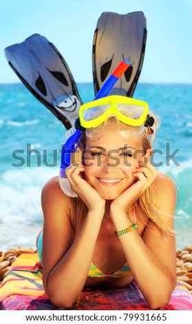 Beautiful female closeup portrait on the beach wearing snorkeling equipment, water sport, healthy lifestyle concept