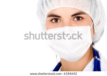 beautiful female doctor portrait using mouth cover and a hat - isolated over a white background