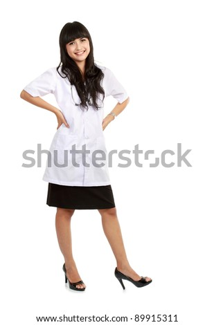 Beautiful Female doctor standing alone in white background