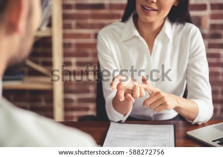 Beautiful female employer in suit is conducting a job interview while sitting in her office Foto stock ©