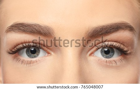 Beautiful female eyes with long eyelashes, closeup - Shutterstock ID 765048007