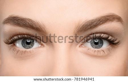 beautiful female eyes with long ...