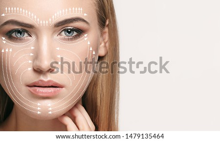 Beautiful female face isolated on grey background. Concept of bodycare, cosmetics, skincare and lifting, correction surgery, beauty and perfect skin. Comparison - old and young. Antiaging.