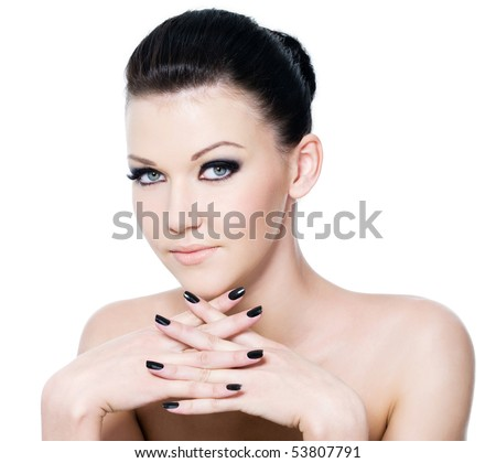 stock photo : Beautiful female face with fashion eye make-up and black