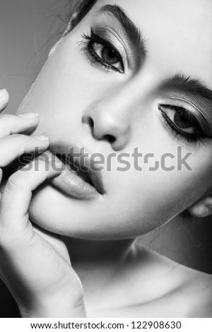 beautiful female face with natural makeup, black and white