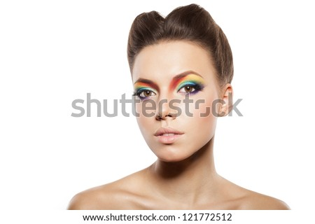 beautiful female face with rainbow makeup. girl looking away