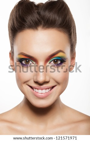 beautiful female face with rainbow makeup. girl showing joy and smiling
