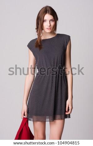 Beautiful female fashion model in polka dot dress isolated over