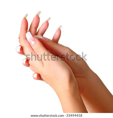 Beautiful female gentle brushes of hands with manicure isolated on a
