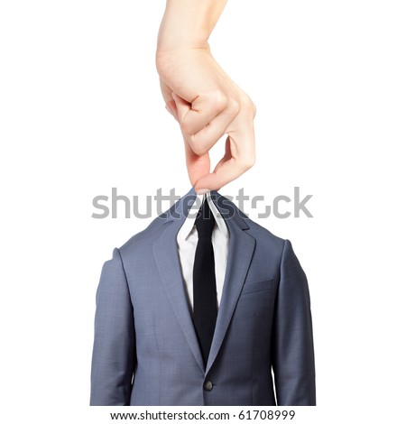 Beautiful female hand holding a gray suit with a tie against white background