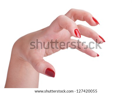beautiful female hand with long red nails attacks isolated on white background