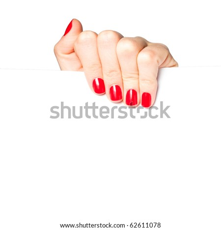 Beautiful female hand with red nails holding a blank sign, isolated on white