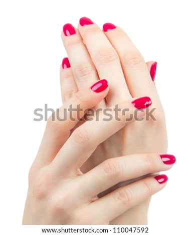 Beautiful Female Hands red manicure shellac  near face concept on a white background. Focus on hand