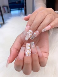 beautiful female hands with 3d flower sculptured natural pink manicure