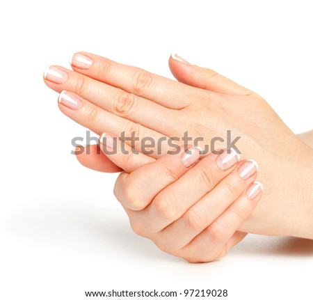 Beautiful female hands with french manicure - stock photo