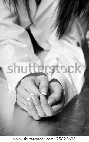 Beautiful female hands with french manicure. Black and white.