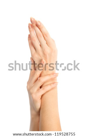 Beautiful female hands with manicure isolated on a white background