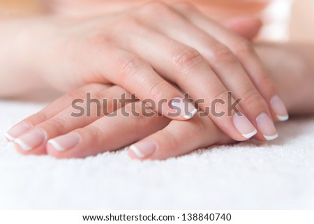 Beautiful female hands with perfect nail french manicure - stock photo