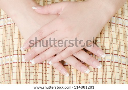 Beautiful female hands with the French manicure