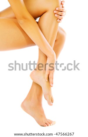 Beautiful female legs. Isolated over white background.