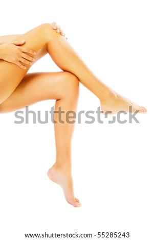 Beautiful female legs. Isolated over white background.
