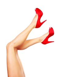 Beautiful female legs with red heels isolated on white background