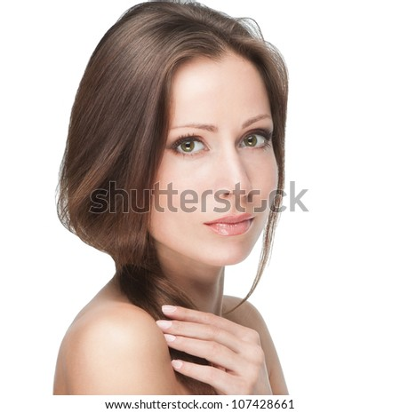 Beautiful female model touching her hair isolated on white background