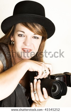 Beautiful female photographer posing with her camera