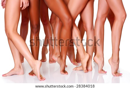 Beautiful female slim feet of group of girls, isolated on a white background, please see some of my other parts of a body images: