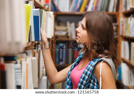 Beautiful female student in a university library