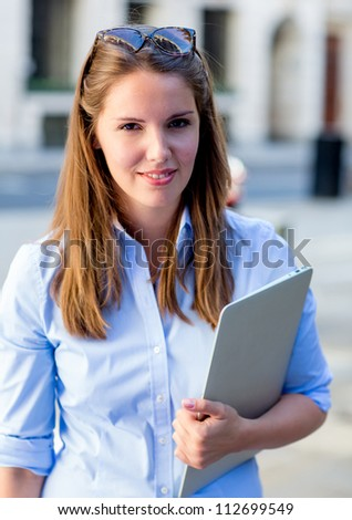 Beautiful female student with a laptop at the university