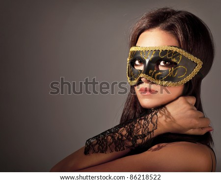 Beautiful female wearing mask, mysterious girl at masquerade,stylish