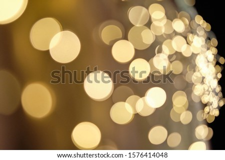Beautiful festive background with the bokeh of many small christmas lights giving it positive emotions for christmas time