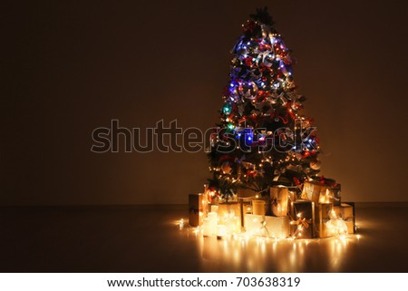 Beautiful fir tree decorated for Christmas in empty room #703638319