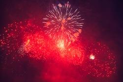 Beautiful Firework at night. Red and blue burst - black sky, long exposure