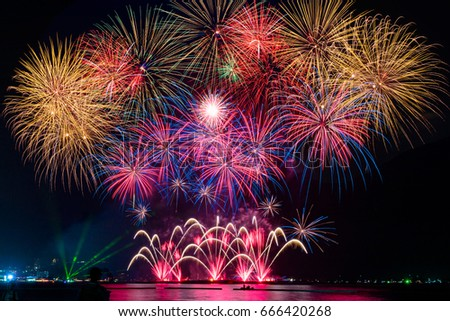 Beautiful firework display on celebration night, showing on the river  #666420268