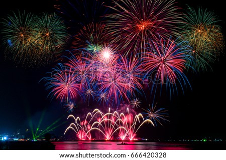 Beautiful firework display on celebration night, showing on the river  #666420328