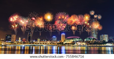 beautiful firework over cityscape of Singapore city at night