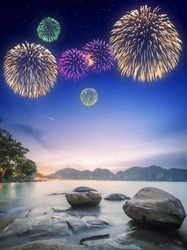 Beautiful fireworks above night tropical landscape with beautiful blue sky and stars. Thailand