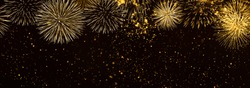 beautiful fireworks in the night background panorama, golden sparks and firecrackers, border isolated on black