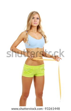 Beautiful fitness girl and measuring tape isolated on white - stock photo
