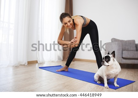 Stock Photo Beautiful fitness girl  make sport exercises with dog