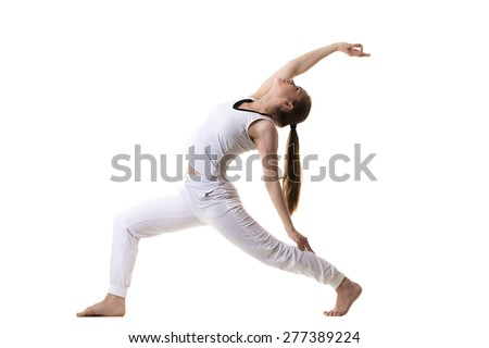 Beautiful fitness model practices yoga or pilates, doing lunge exercise, standing in Reverse Warrior Pose, Crescent variation, Viparita Virabhadrasana, side view, studio shot, isolated