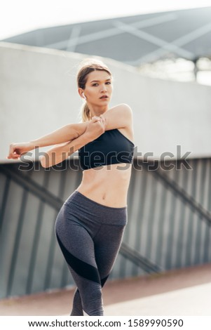 Beautiful fitness sport girl with fit body in sportswear exercising outdoors, stretching, yoga, outdoor sports, urban style.