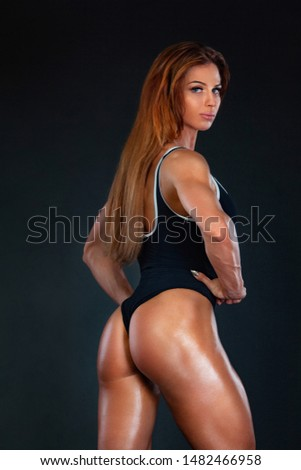 Beautiful fitness woman athlete and bodybuilder with perfect body wearing sport clothes for the gym training. Individual sports. Sports recreation. #1482466958