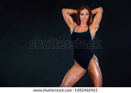 Beautiful fitness woman athlete and bodybuilder with perfect body wearing sport clothes for the gym training. Individual sports. Sports recreation. #1482466961